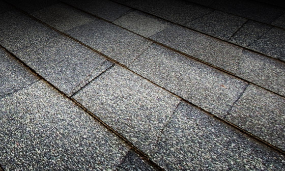 A view of a roof with high quality gray shingles.
