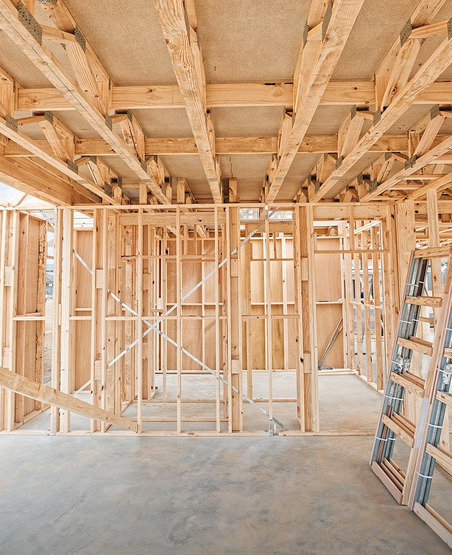 Framing inside a house under construction. The best beginning for any building, repair, or improvement project is finding a reliable contractor you can trust.